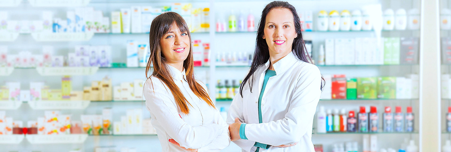 female pharmacist smiling at the camera