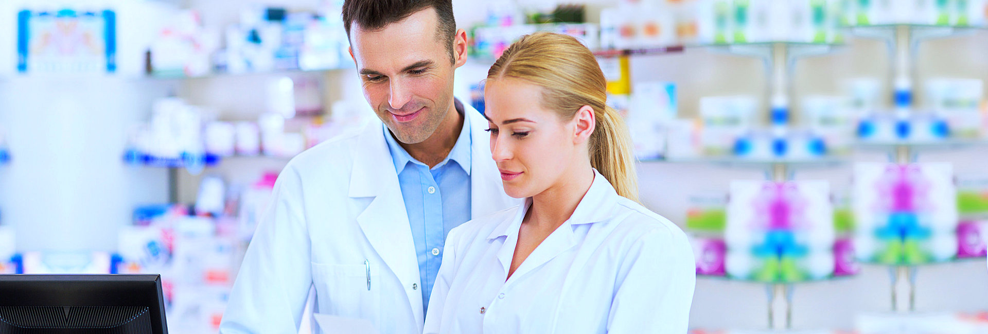 beautiful female pharmacist smiling with her partner