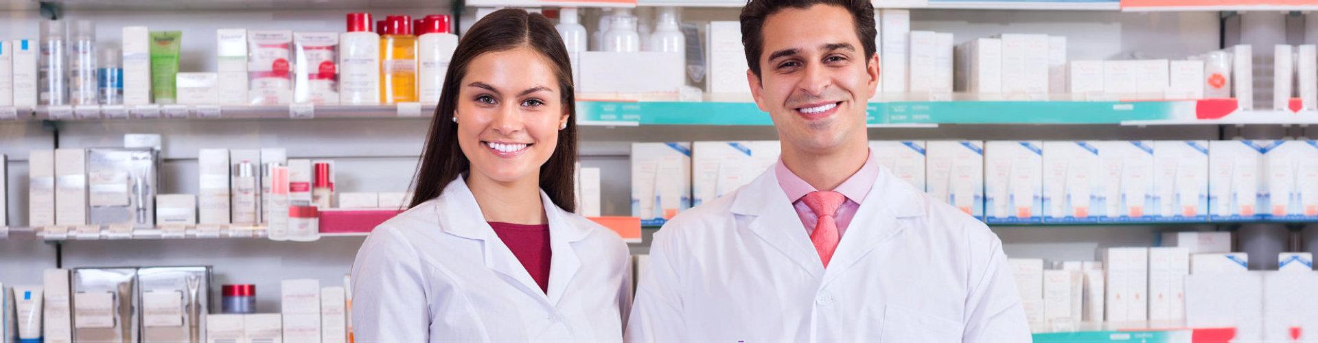pharmacist smiling in the pharmacy