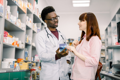 young pharmacist and a customer talking